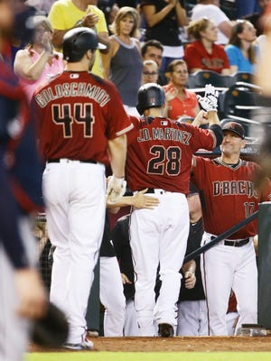 Arizona Diamondbacks' J.D. Martinez reacts after hitting a two-run home run against the Atlanta Braves in the 8th inning on Wednesday, Jul. 26, 2017 at Chase Field in Phoenix, Ariz.