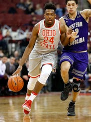 Ohio State forward Andre Wesson (24) dribbles by Western