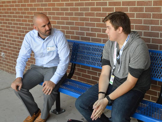 Dr. Jake Long chats with student Josh Snow, who was waiting for his second-block class at Mountain Home High School after returning from the ASUMH Technical Center, where he's in a mechatronics class. Tuesday was the first day of classes for students in Mountain Home Public Schools.