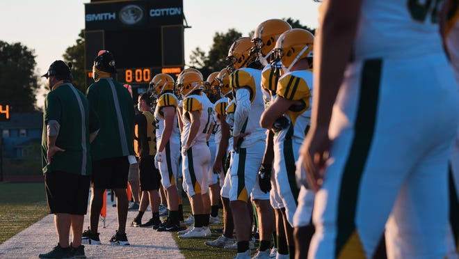Rock Bridge players stand on the sidelines during a football game at Smith-Cotton High School last Friday.