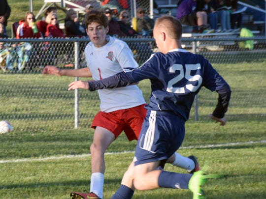 Riverheads' Jack Matherly races to the ball with Page County's Ben Shenk during the first half of their Shenandoah District boys soccer game on Monday, May 8, 2017, at Riverheads High School. The Gladiators won 2-0.