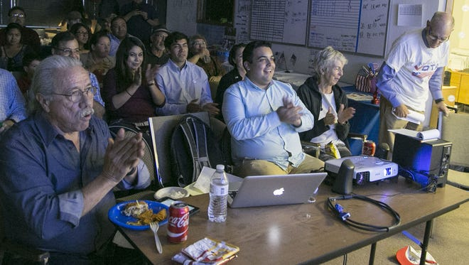 Actor Edward James Olmos (left) watches the Clinton-Trump debate with others at Mi Familia Vota in Phoenix on Sept. 26, 2016.