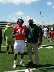 Former FSU linebacker Bradley Jennings with son Bradley Jennings Jr., a freshman linebacker at UM.