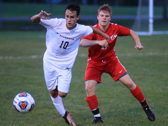 Plymouth's Ryan Dickerson (No. 10) goes head-to-head