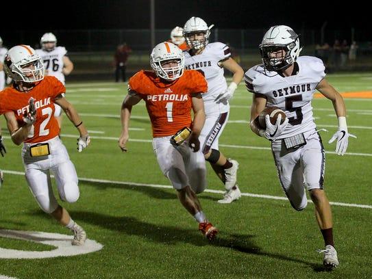 Seymour's Garrett Siegert (5) takes the ball around