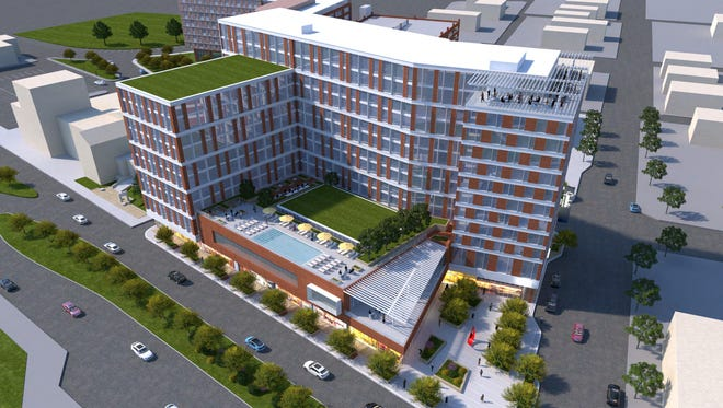 A rendering of a 12-story hotel and apartment complex proposed at the corner of Grand River Avenue and Abbot Road in downtown East Lansing. The project has been approved, but the developer said it's no longer feasible after the city approved a different tax rebate than originally set forth.