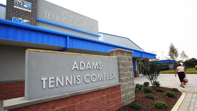 Visitors move toward the door of the Adams Tennis Complex to attend the open house of the facility Tuesday, June 30, 2015.