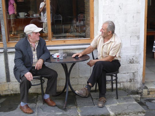 Two Albanians shoot the breeze.