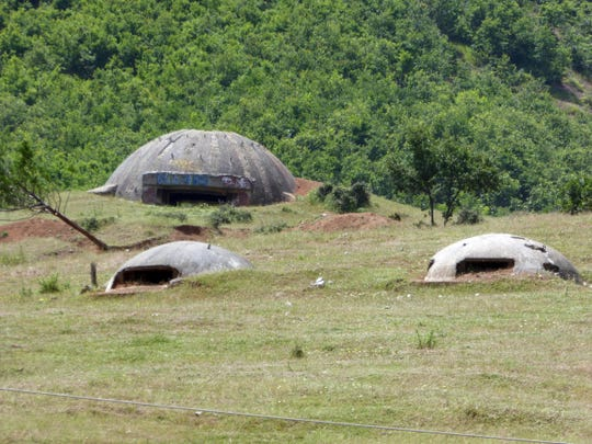 These Albanian bunkers are among 700,000 constructed by a brutal Communist dictator who closed the countries borders after WWII in fear of an Allied invasion. They still are visible everywhere, including at the side of highways.