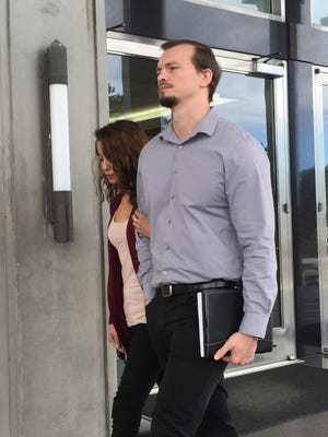 Nicholas Shoemake, executive assistant at Guam Medical Transport, right, departs an arraignment hearing at the U.S. District Court of Guam in Anigua on Jan. 26, 2016.