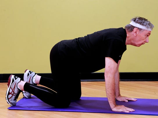 Jack Lofte, demonstrates the yoga cow stretch that