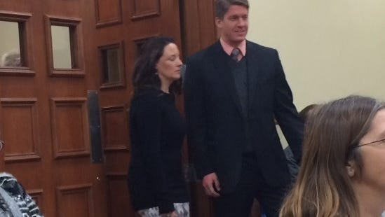 Former Door County Humane Society executive director Carrie Counihan enters the courtroom Thursday with her attorney,