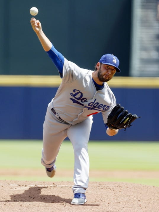 Dodgers pitcher Mike Bolsinger throws against the Braves on Wednesday in Atlanta. Bolsinger got the win in L.A.'s 3-1 victory.
