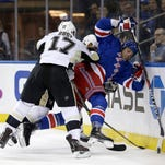 Rangers forward Viktor Stalberg, right, is checked by Pittsburgh Penguins' Bryan Rust, left, and Trevor Daley during the second period Sunday.