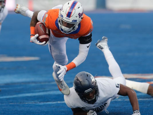 Boise State wide receiver Cedrick Wilson is upended by Nevada defensive back Dameon Baber during the first half of an NCAA college football game in Boise, Idaho, Saturday, Nov. 4, 2017. (AP Photo/Otto Kitsinger)