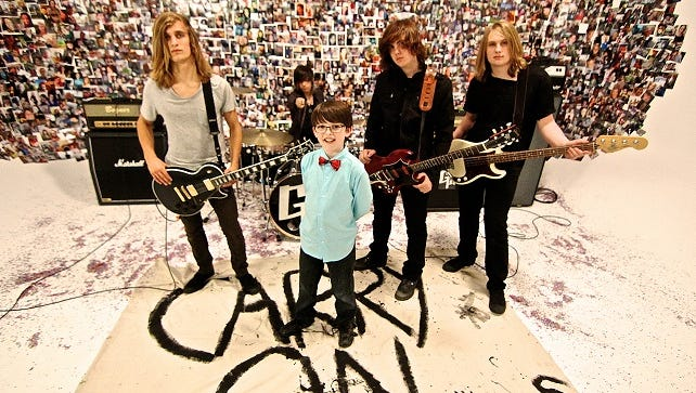 "Colin Cunningham, 11, of Richland, Mich., with the band Galvanized Souls from the video of their new single, ""Carry On."""