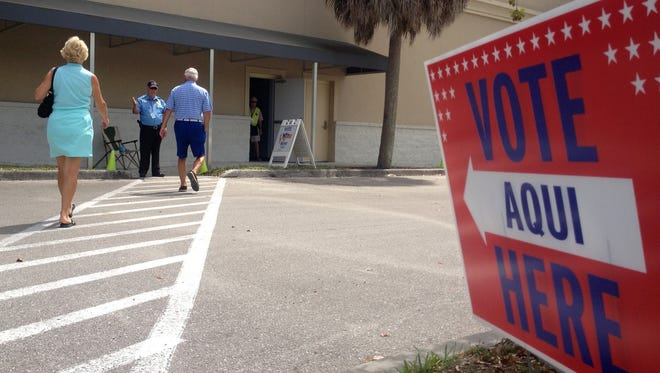 File Photo: Barrett And Karon Nelson of South Fort Myers are greeted by security guard Ray Hughes at the Lee County Elections Center off US 41. The couple was there to vote on the last day of early voting in the Congressional district 19 special election in 2014.