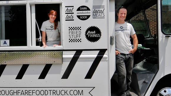 Jessica and Neil Barley pose with their new-to-Greenville food truck ThoroughFARE on Friday, Aug. 9, 2013.