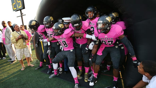 Warren Central players get set to take the field against Ben Davis in Friday night's game held at Warren Central High School on September 19, 2014.
