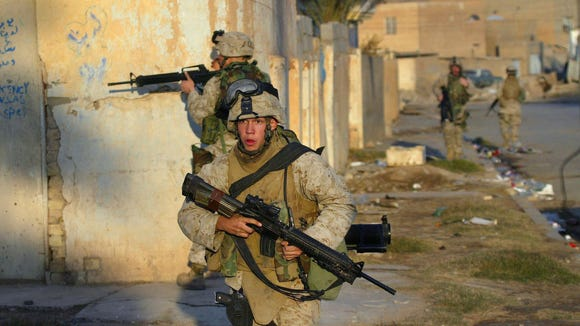 Marines fight in Ramadi, Iraq, in 2004.