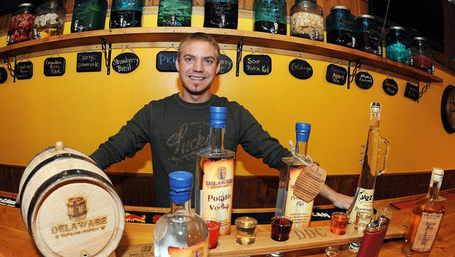 Zachary King poses behind the bar at Delaware Distilling Co. in 2014.