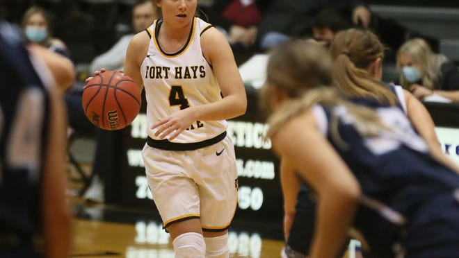 FHSU's Lauryn Reither brings the ball up for the Tigers against Washburn on Dec. 1.