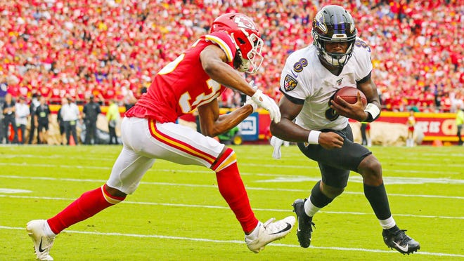 Baltimore Ravens quarterback Lamar Jackson (8) tries to elude Kansas City Chiefs cornerback Charvarius Ward during a game at Arrowhead Stadium last fall. Jackson said he doesn't like being compared to the Chiefs' Patrick Mahomes, who agreed to the richest contract in professional sports history earlier this week.