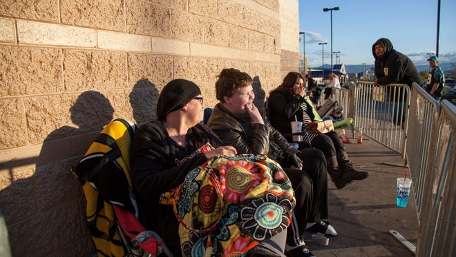 After nine hours of waiting Jen and Chris Harper from Toquerville hold their place at the front of the line at Target in anticipation for a Black Friday discount on a TV Thursday, Nov. 26, 2015.