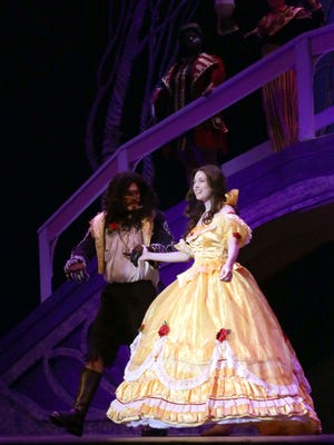 Lauren Everett as Belle and Kyle Miller as the Beast, rehearse at The Renaissance Theatre for the play, Beauty and the Beast.