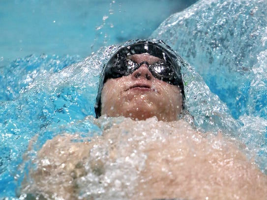 Port Washington's Zach Miller competes in the 100-yard