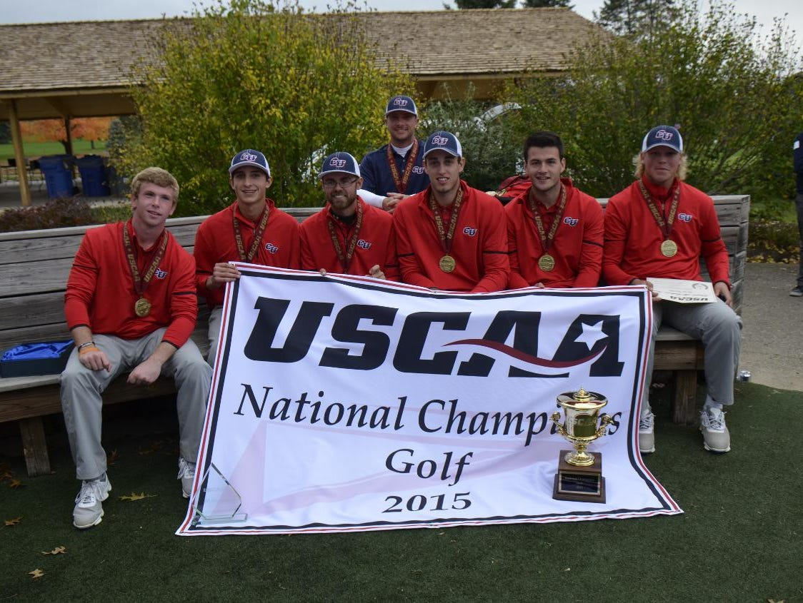 The Cleary University golf team poses with the national championship trophy after winning the USCAA national title on Tuesday. It's the first national title in any sport for the Cougars.
