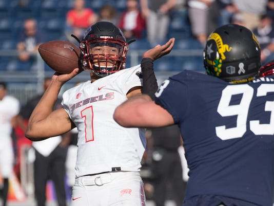 UNLV quarterback Armani Rogers throws as he is rushed by Nevada's Jordan Silva in the first half of an NCAA college football game in Reno, Nev. Saturday, Nov. 25, 2017. (AP Photo/Tom R. Smedes)