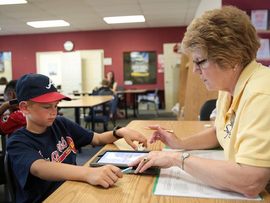 Mary Wiktor, right, a reading tutor, works with Kody