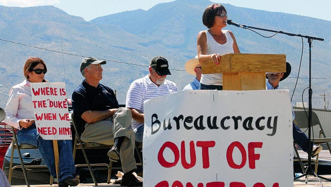 In this May 31, 2014 file photo, state Rep. Yvette Herrell talks about private property rights, states rights and the federal government over stepping its control of the Lincoln National Forest. Congressman Steve Pearce and Otero County Commissioner Ronny Rardin are seated behind Herrell.