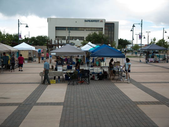 Vendors set up booths on Plaza de Las Cruces before the Wednesday Night Market Wednesday July 12, 2017.