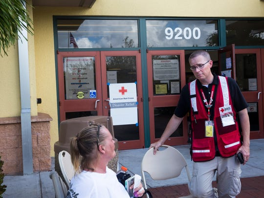 "Bryan Hartmann, a Red Cross shelter manager, talks with residents outside the emergency shelter at the Estero Community Park Recreation Center on Sunday, Sept. 24, 2017. ""I'm always worrying about people,"" he said. ""It's heartbreaking when you see others in total despair, when life as they know it is turned upside-down."""