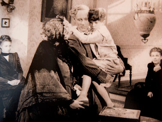 In this archive photograph Mickey Kuhn, 6, is held by actor Leslie Howard during the filming of a scene in 1939's iconic film Gone With the Wind. Kuhn, now 85, would go on to have a lengthy career during Hollywood's Golden Age up until the late 1950's acting in 30-plus films including A Streetcar Named Desire, Red River, and Broken Arrow. Seen here in his Naples home Wednesday, Dec. 6, 2017.