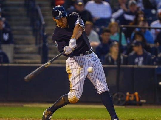 New York Yankees right fielder Aaron Judge (99) hits a home run during the fourth inning of a Spring Training baseball game against the Baltimore Orioles at George M. Steinbrenner Field.
