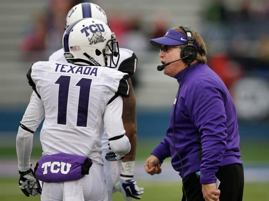 TCU head coach Gary Patterson, right, talks with cornerback Ranthony Texada (11) and safety Chris Hackett on Nov. 15, 2014.