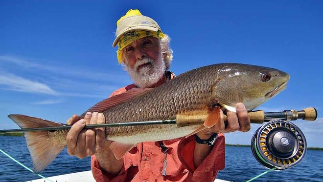 Nova Scotian Perry Munro used a Giblet shrimp pattern to sight-fish this 25-inch redfish in clear water near Pineland in Pine Island Sound, on a Wildfly Charter with Matlacha Capt. Gregg McKee.