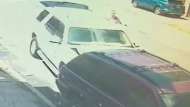 Paterson police re asking for the public's help in identifying the suspect are a driverless SUV plowed into a parked vehicle in Paterson's Riverside neighborhood on June 14.