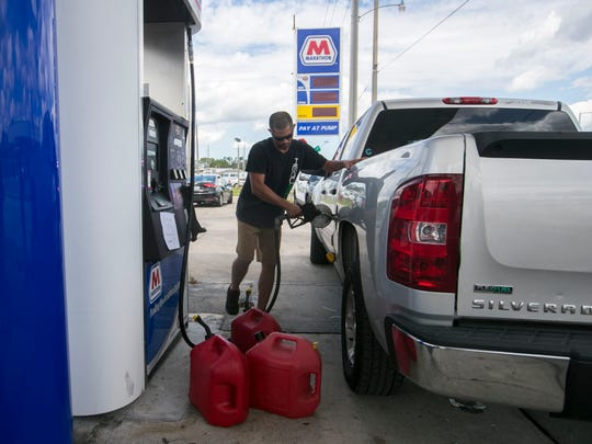 Lazaro Llerena gets gas at the Marathon gas station