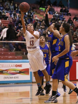 Shiprock's Paige Dale drives through the Bloomfield defense for a layup on Jan. 22 at the Chieftain Pit in Shiprock.