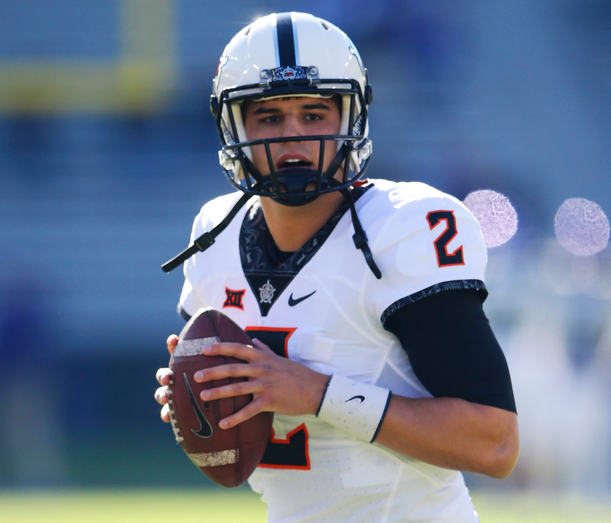 Oklahoma State Cowboys quarterback Mason Rudolph (2) throws before the game against the TCU Horned Frogs at Amon G. Carter Stadium.