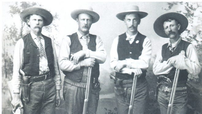 Buckey O'Neill and his posse spent more than three weeks successfully chasing down bandits who robbed a train at Canyon Diablo in 1889. The posse (from left) are Carl Holton, Ed St.Clair, Buckey O'Neill and Jim Black.