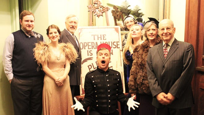 """All smiles: the cast of """"Lend Me a Tenor"""" strikes a pose at the Monticello Opera House."""
