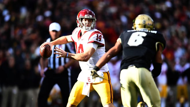 USC Trojans quarterback Sam Darnold (14) throws the ball in the first half against the Colorado Buffaloes.