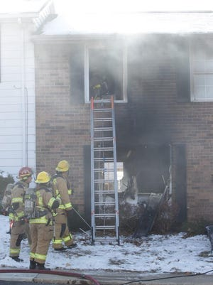 """Crews battle a """"fully involved"""" apartment complex fire in Northern Kentucky."""