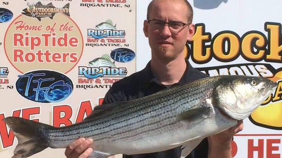Issac Linton was able to find a 13.5 pound striper in the Brigantine surf.
