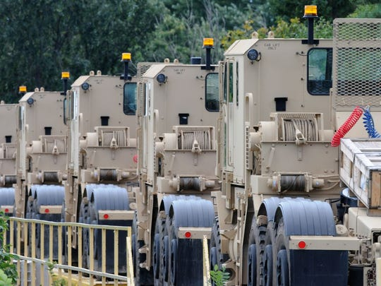 Oshkosh Corp secured $566 million to continue building trucks for the U.S. military and a share of $433 million more for modifications to trucks.